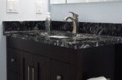 Modern Bathroom sink interior in black closet and black marble countertop