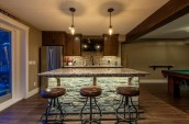 Modern Kitchen Interior in marble counter top stone decorated with 3 leather cover bar stools