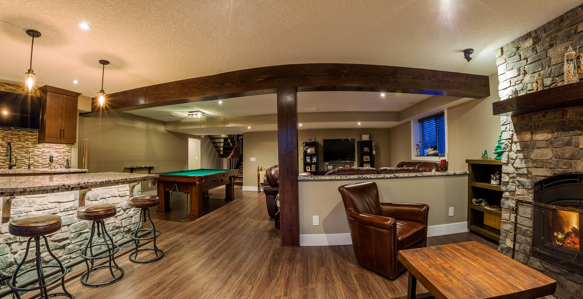 Modern living room interior with bar setting with marble stone leather cover bar stools pool table in the middle of the room with leather couches