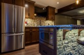 Modern Kitchen Interior with double door fridge and marble countertop with microwave installed on the kitchen island stone decorated with