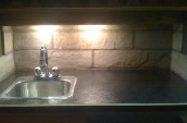 marble countertop with dimmed highlights over the bar sink