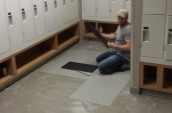 workers in the brand new locker rooms placing assembling the floor carpets