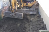 A worker with a excavator is operating for the levelled the ground