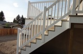 White outdoor staircases is installed with white handrails