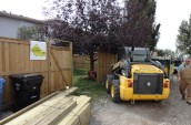 Carnegie Contracting workers are preparing on the renovation project with yellow excavator