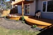Modern Patio wooden deck with minimal garden in grey stones