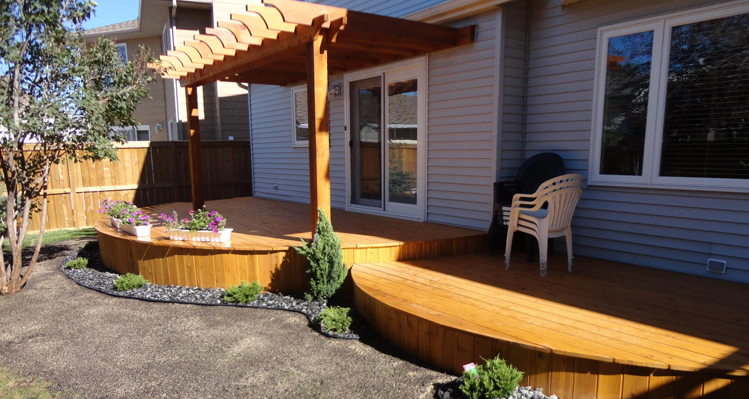 Modern Patio wooden deck with minimal garden in grey stones