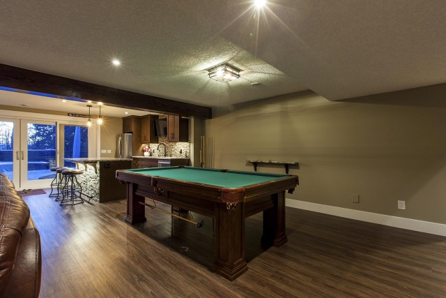 snooker table with bar in background