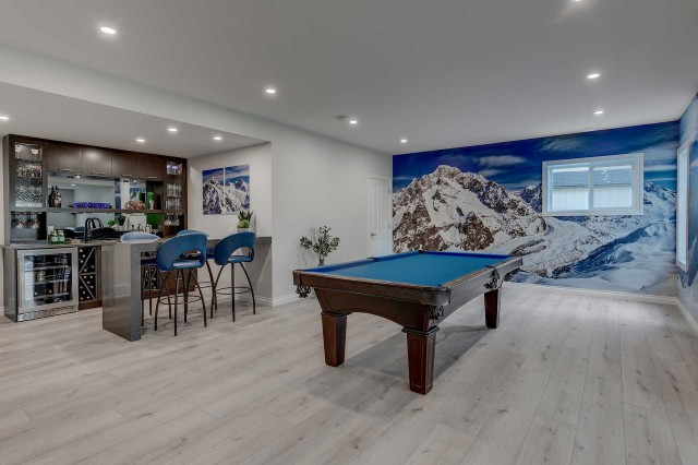 pool table in room with mural of a snow-covered mountain