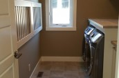 looking through door leading into renovated laundry room with washer and dryer