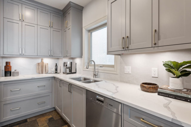 double sink in kitchen with coffee maker in corner