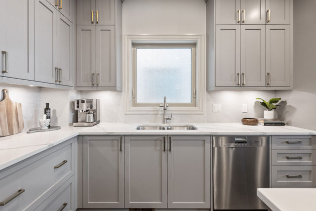 double sink in kitchen with dishwasher to the right
