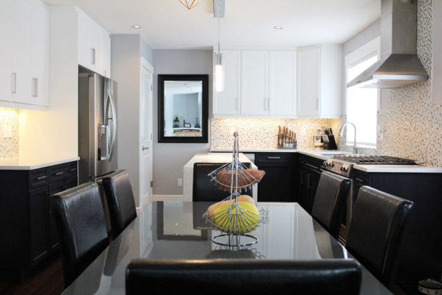 six seater dinner table with kitchenette in background