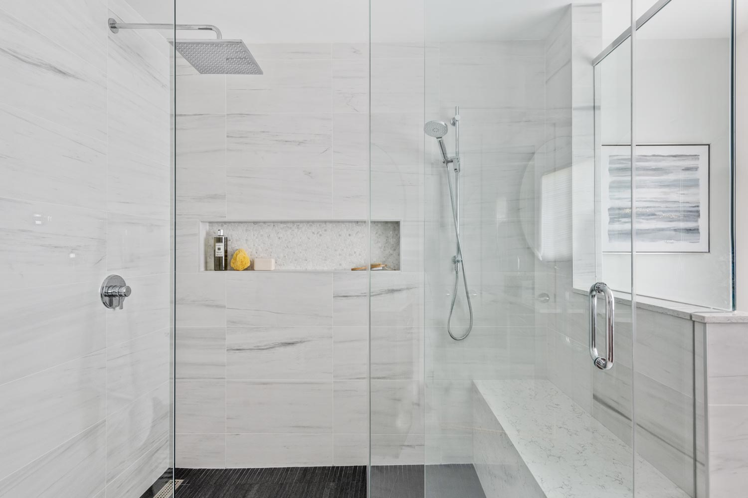 shower with glass door and recessed shelf