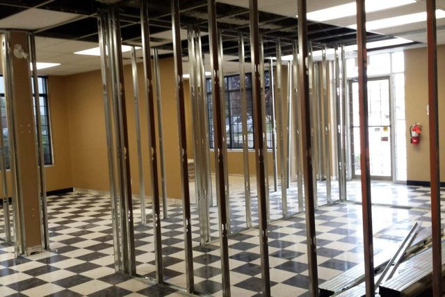 hallway in commercial building with skeleton framework for offices