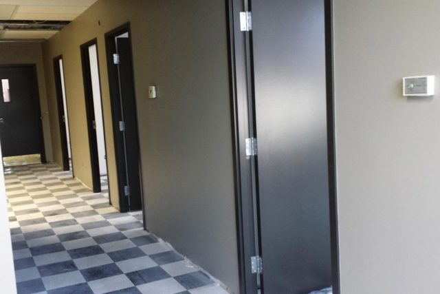 hallway with chequered floor tiling in commercial building