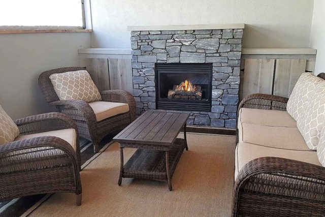 finished fireplace with table and chairs in foreground