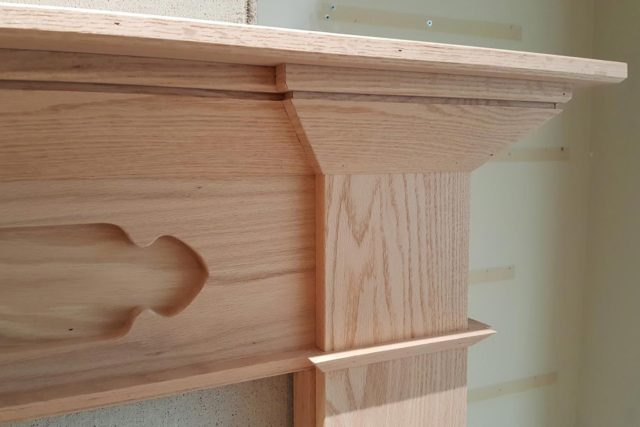 close up of fireplace wood paneling