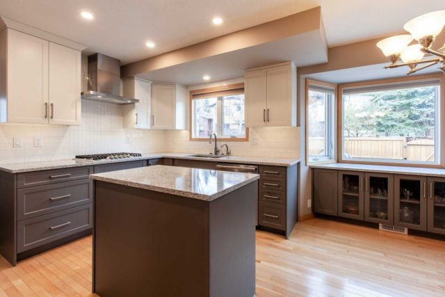 kitchen view showcasing gas hob double sink, windows and workstation