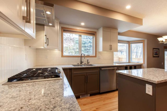 kitchen view showcasing gas hob double sink and windows