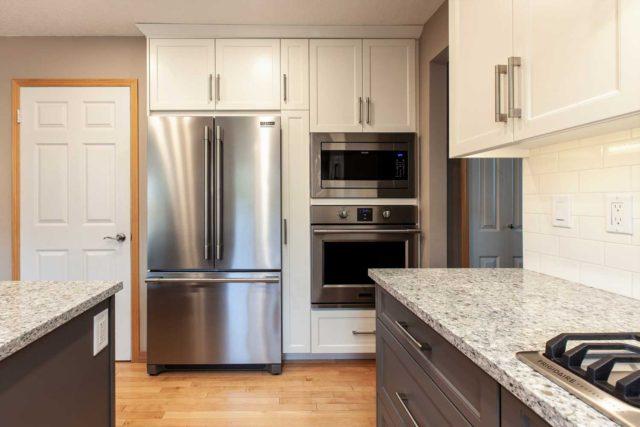 kitchen view showcasing oven and fridge/freezer